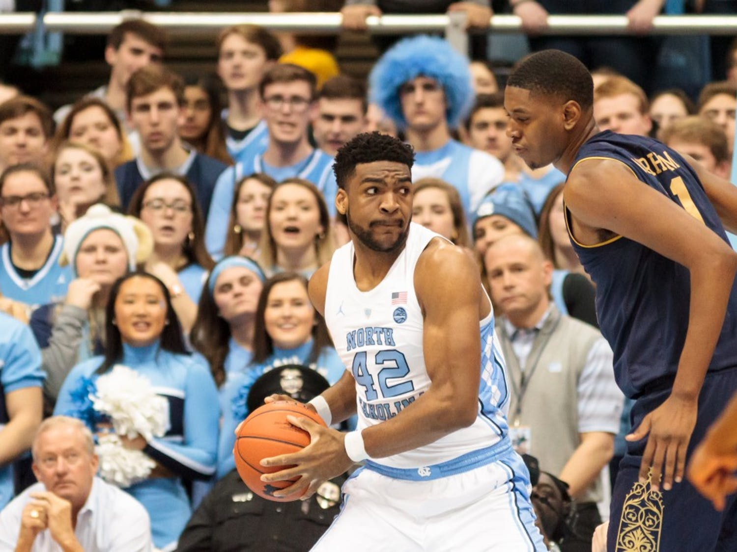 UNC forward Brandon Huffman (42) defends the ball from Notre Dame forward Juwan Durham (11) during the home men's basketball game in the Smith Center on Tuesday, Jan. 15, 2019. The final score was 75-69.