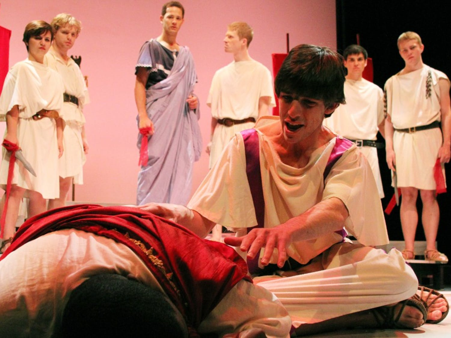Freshman Jackson Bloom, playing the role of Antony, reaches towards the fallen Caesar, played by senior Jeffrey Sullivan, during the play's final dress rehearsal.