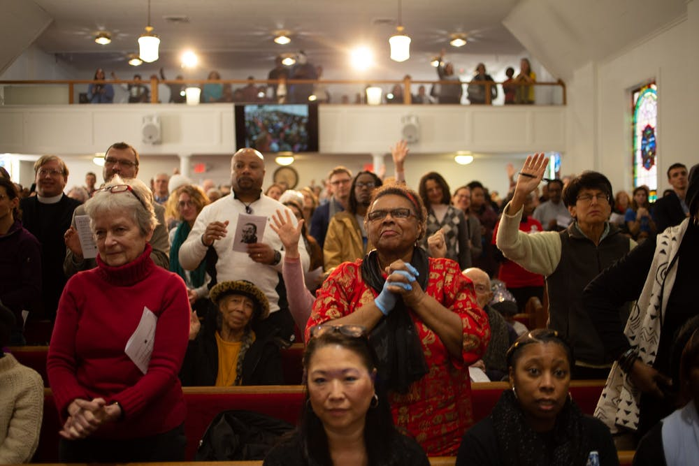 <p>Attendees gather in the sanctuary of First Baptist Church in Chapel Hill for worship during a Martin Luther King Jr. rally sponsored by Chapel Hill-Carrboro NAACP's Youth Council on Monday, Jan. 20, 2020. Hundreds of members of the community gathered to consider King's legacy in Chapel Hill and beyond.</p>