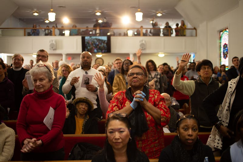 Attendees gather in the sanctuary of First Baptist Church in Chapel Hill for worship during a Martin Luther King Jr. rally sponsored by Chapel Hill-Carrboro NAACP's Youth Council on Monday, Jan. 20, 2020. Hundreds of members of the community gathered to consider King's legacy in Chapel Hill and beyond.