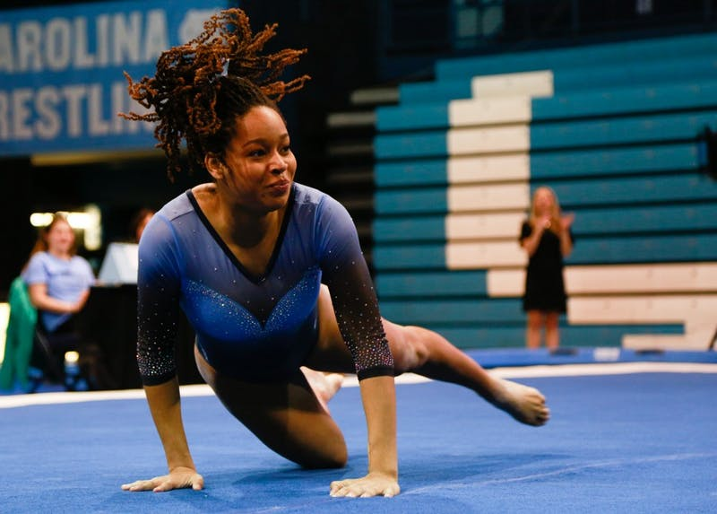 Junior Mikayla Robinson performs her floor routine at the women's gymnastic meet against Towson University on Saturday, Feb. 9, 2019 in Carmicheal Arena.