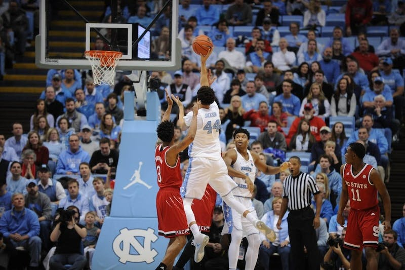 Forward Justin Jackson (44) takes a floater against N.C. State on Jan. 8, 2017, in the Smith Center.