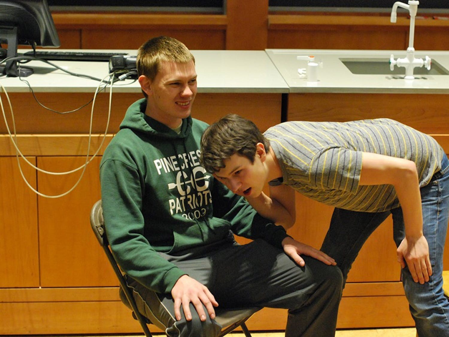 """Senior Joey Rasmus (left) and Junior Eric Clayton (right) rehearse an improv skit. False Profits will be performing comedic stand-up, sketches, and improv at 8:00 tonight in Chapman 201. """"We are excited to make the world a funnier place,"""" says Junior Eric Clayton."""
