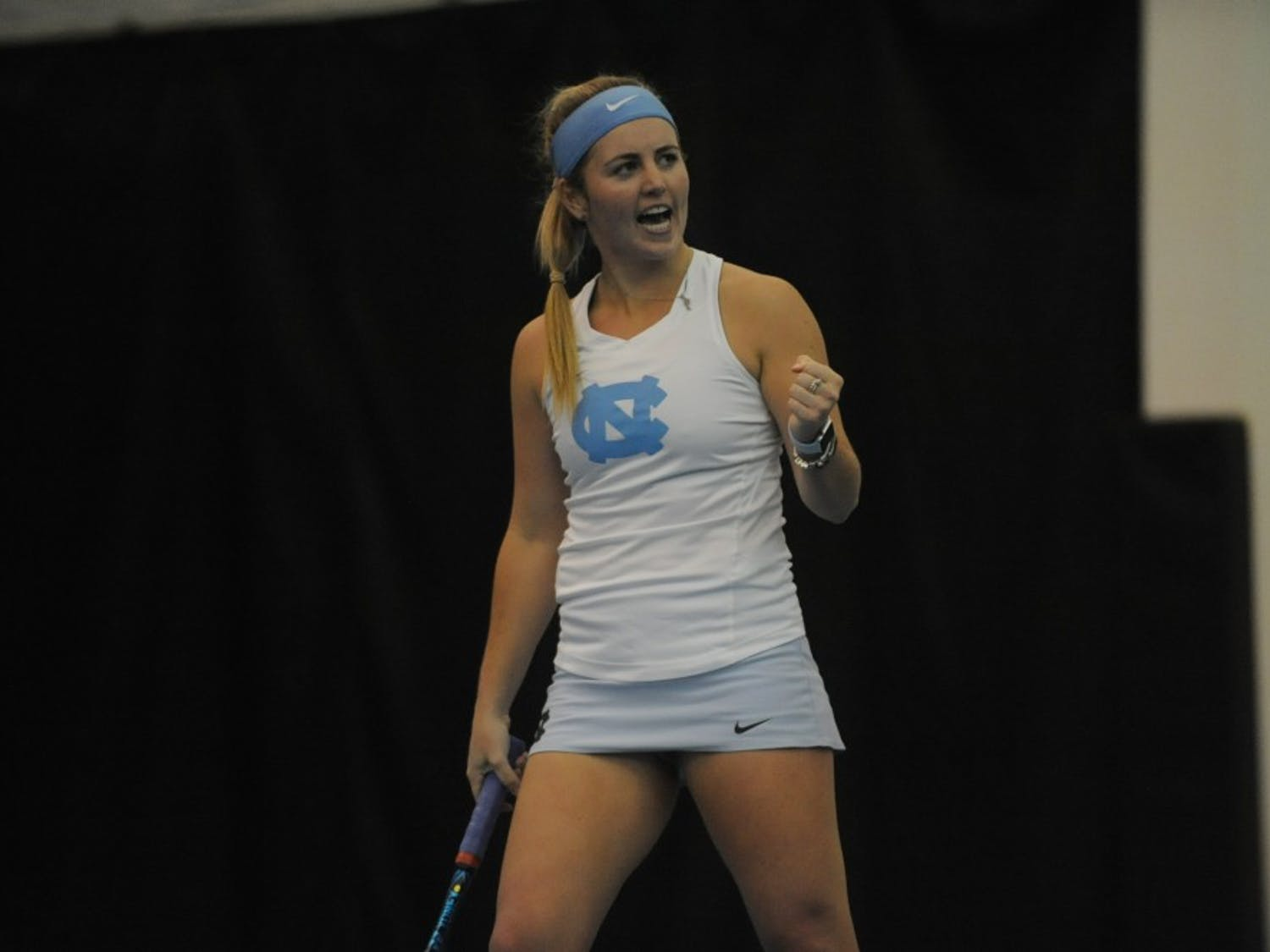 UNC women's tennis junior Makenna Jones celebrates after winning a game during a singles match against Louisville on Sunday, March 3, 2019. UNC won the match against the Cardinals.