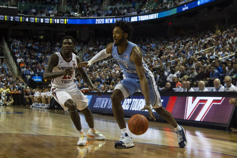 Sophomore guard Leaky Black (1) dribbles during the first-round game of the ACC tournament against Virginia Tech in the Greensboro Coliseum Complex on Tuesday, March 10, 2020. UNC beat Virginia Tech 78-56.