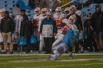 UNC senior linebacker Dominique Ross (3) tackles Mercer freshman wide receiver Yahsyn McKee (16). The Tar Heels took the lead at halftime against the Bears 42-0 at Kenan Memorial Stadium on Saturday, Nov. 23, 2019.