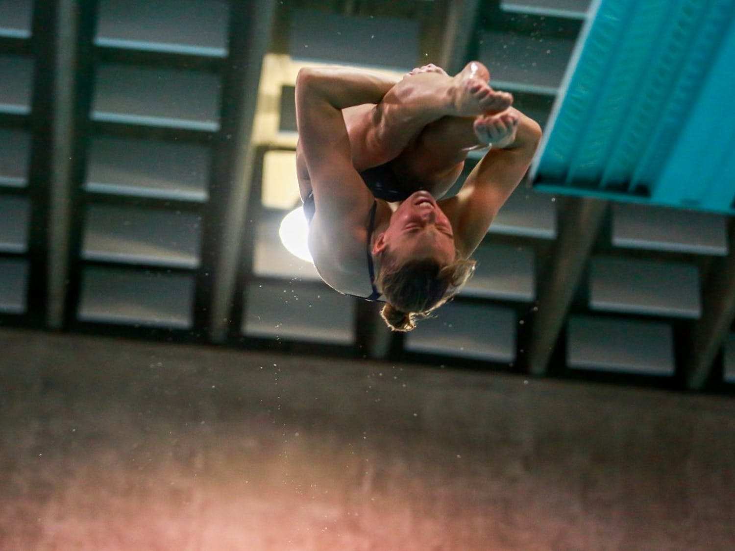 Emily Grund dives during the home swim and dive meet vs. Duke in Koury Natatorium on Saturday, Feb. 2, 2019.