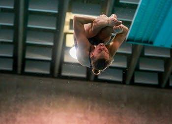 Emily Grund dives during the home swim and dive meet vs. Duke in Koury Natatorium on Saturday, Feb. 2, 2019.