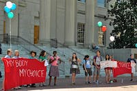 Students from different organizations gathered in front of Wilson Library to form a human chain and to protest the anti-abortion displays.