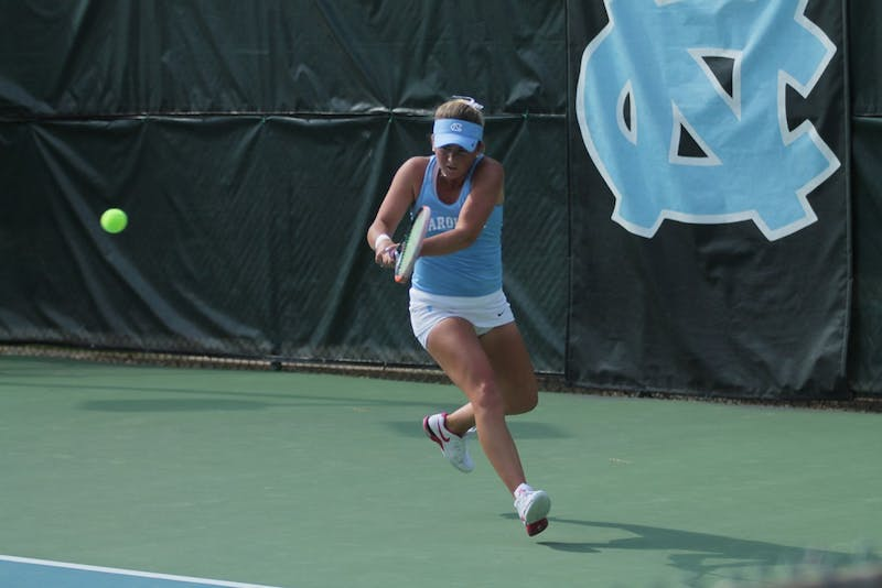 Makenna Jones hits a backhand shot against visiting Virginia Tech, in the Tar Heels 7-0 shutout win over the Hokies.