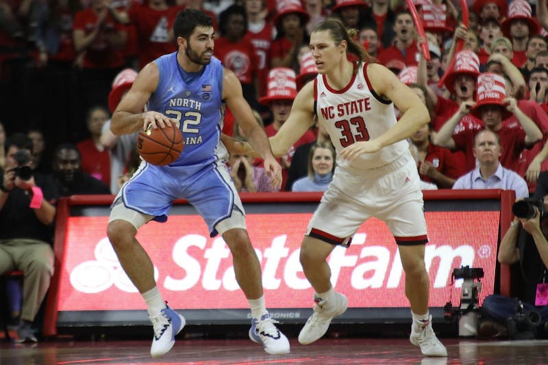 NC State forward Wyatt Walker (33) guards UNC forward Luke Maye (32) in PNC Arena Tuesday, Jan. 8, 2019. UNC defeated NC State 90-82.