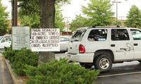 Towing signs in Carr Mill Lot
