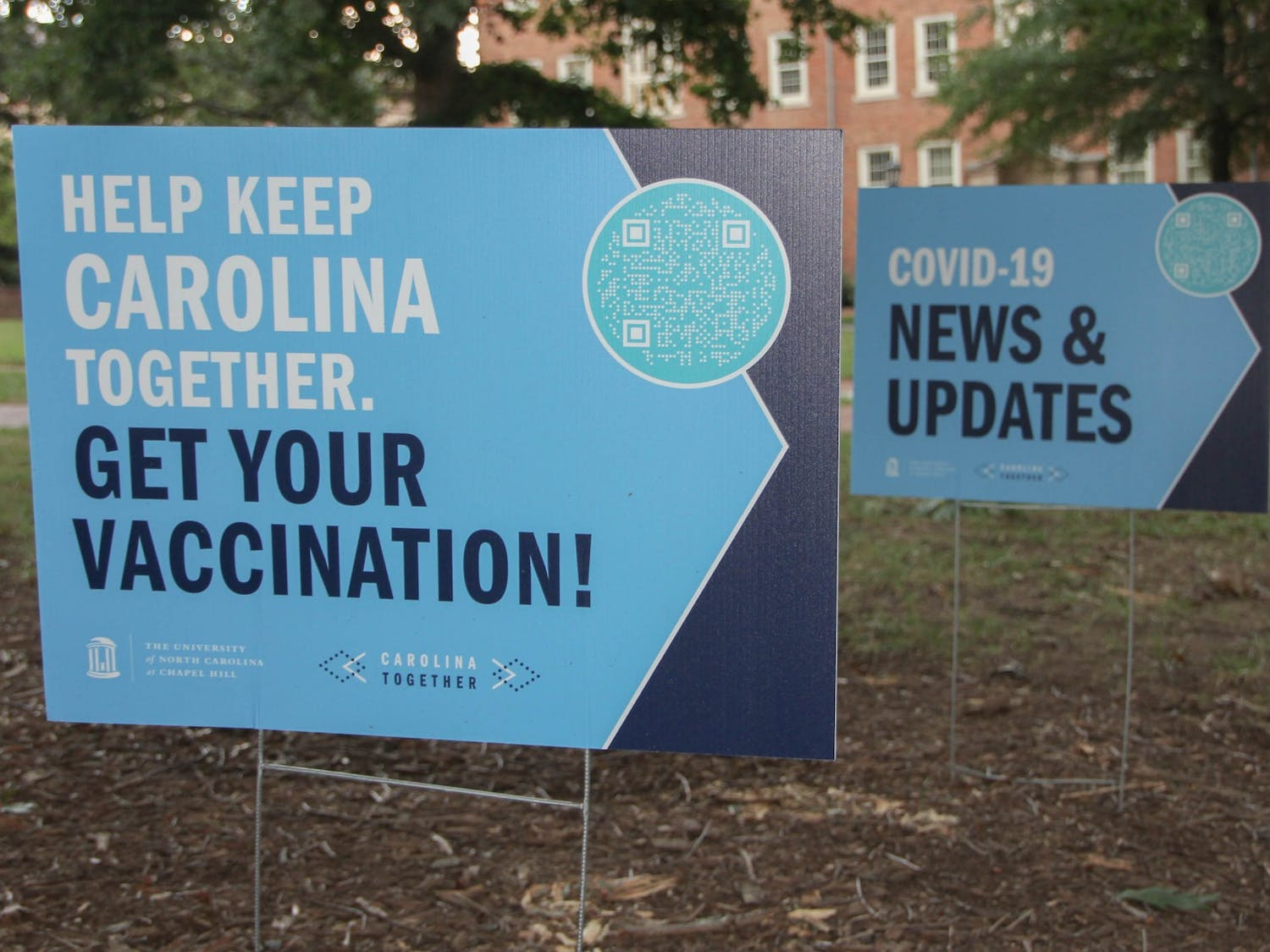 Signs reminding Tar Heels' to get vaccinated were photographed on the Pit on Aug. 22, 2021. Unlike other major universities, UNC has not mandated the COVID-19 vaccine.