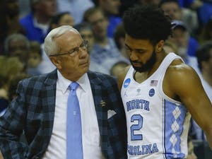 North Carolina guard Joel Berry (2) is met by Coach Roy Williams after injuring his ankle in the first half of Sunday's Elite Eight matchup against Kentucky in Memphis.