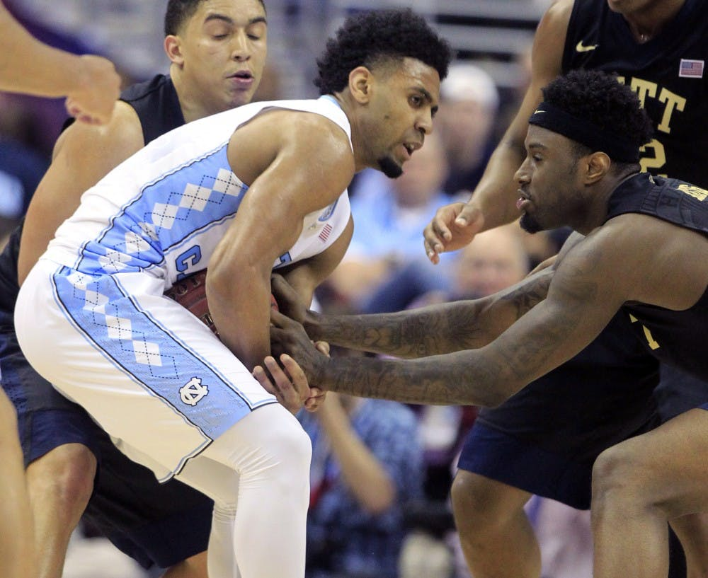 North Carolina's Joel Berry II (2) keeps the ball from Pittsburgh's Jamel Artis (1) during the second half of the quarterfinals of the 2016 New York Life ACC Tournament on Thursday, March 10, 2016, at the Verizon Center in Washington, D.C. (Ethan Hyman/Raleigh News & Observer/TNS)
