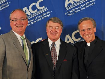 Notre Dame Reverend John Jenkins (right) and Athletic Director (left) posses with ACC Commissoner John Swafford (center).