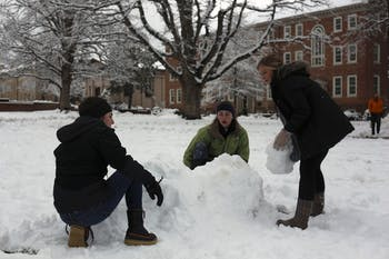 (From left to right) Megan Carlin, Sinclair McLean and Sarah Graves build an igloo on the lower quad in front of South Building on Thursday.