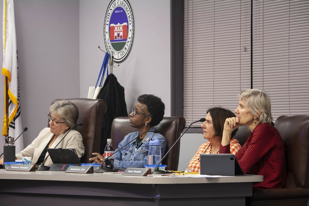 Carrboro residents debate UNC coal plant at Tuesday's town council meeting