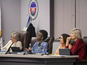 (From left) Carrboro Mayor Lydia Lavelle and Council Members Barbara Foushee, Jacquelyn Gist and Susan Romaine listen to residents speak about UNC's coal plant on Feb. 4, 2020. A resolution calling for UNC to cease operations of this plant has been proposed to the Town Council and is an ongoing debate.