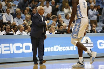 Roy Williams yells at his players after a Stanford basket.