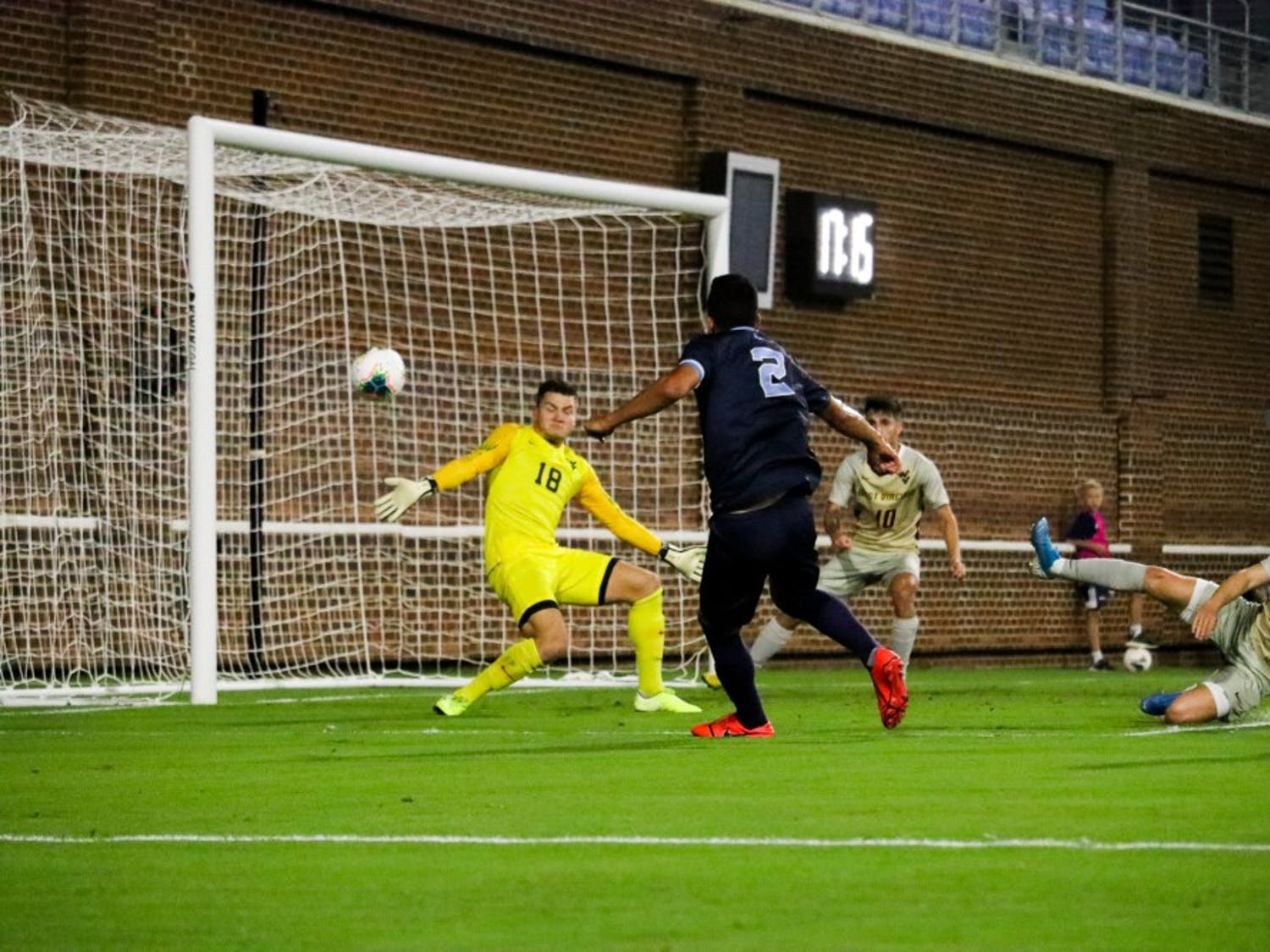 Senior midfielder Mauricio Pineda (2) scores a goal against WVU goalie Steven Tekesky (18) in the first half during the team's 3-1 victory over West Virginia on Tuesday, Oct. 8, 2019 on Dorrance Field. Pineda scored two goals during the win.