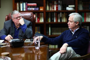 Political consultants Carter Wrenn (left) and Gary Pearce meet in Wrenn's office Wednesday. The two have been friends for several years and have collaborated on a blog for 10 years.