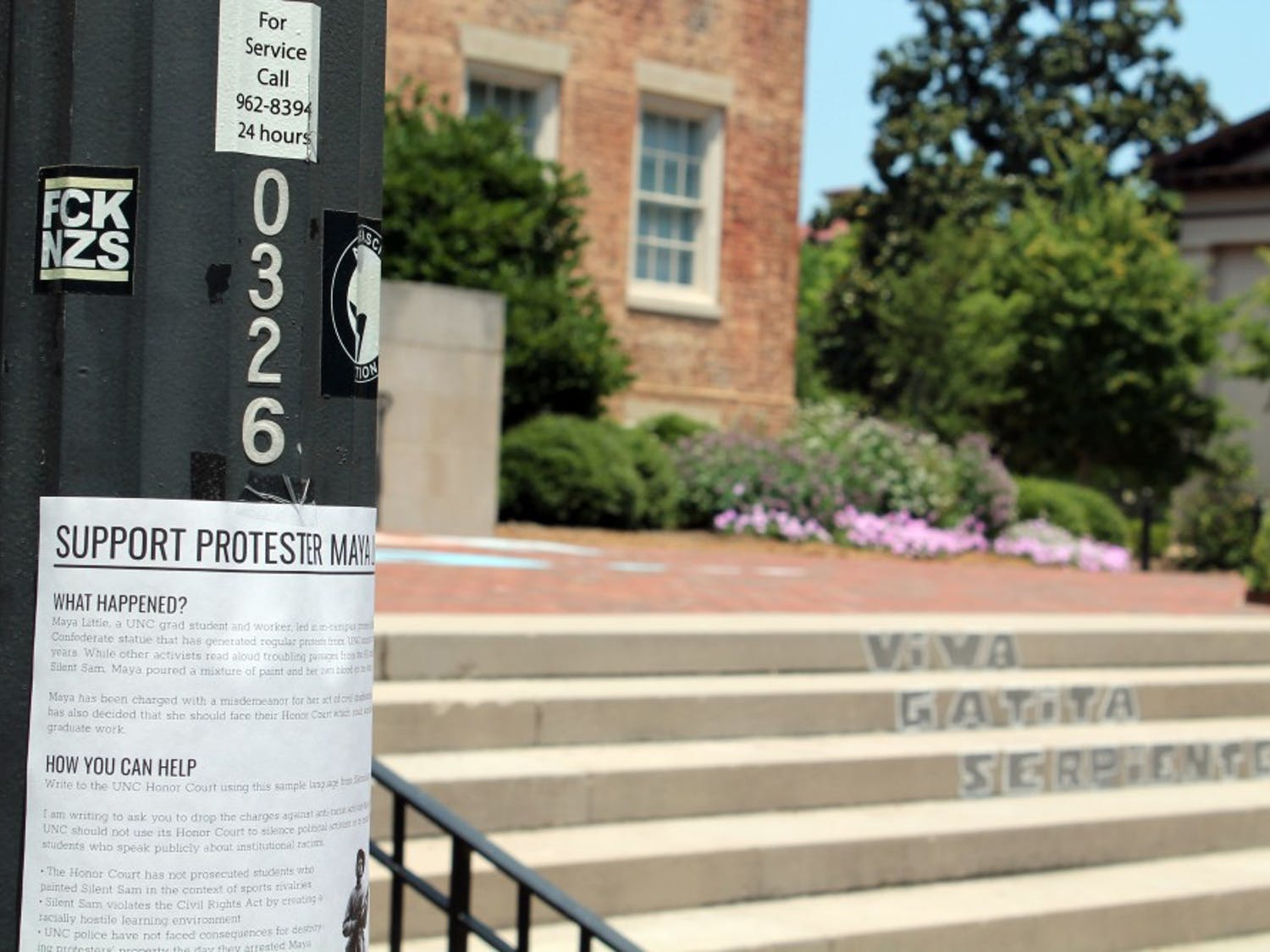 """On July 11, protestors chalked """"We Have Receipts"""" and """"McCracken Lied"""" on the bricks in front of South Building. Additionally, """"Viva Gatito Serpiente"""" was chalked onto the stairs, near flyers in support of Silent Sam protestor Maya Little."""