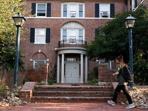 A resident enters Spencer Residence Hall on Sunday, Mar. 1, 2020. Built in 1924, Spencer was the first all-female residence hall, but is now co-ed.