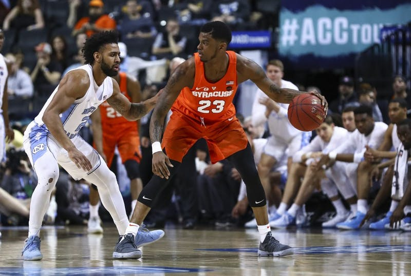 North Carolina's Joel Berry II (2) guards Syracuse's Frank Howard (23) in the second round of the 2018 ACC Tournament on Wednesday night in Brooklyn. Photo courtesy of David Welker, theacc.com