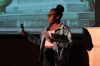 Kimani Smith, a sophomore psychology major, states her opinion on the removal of Silent Sam at a town hall organized by MADO and Black Congress on Monday Oct. 29, 2018.