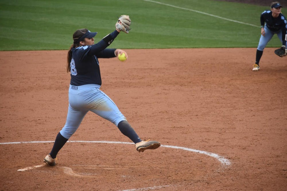 <p>Brittany Pickett (28) pitches against Wisconsin on Feb. 17 in Anderson Stadium.</p>
