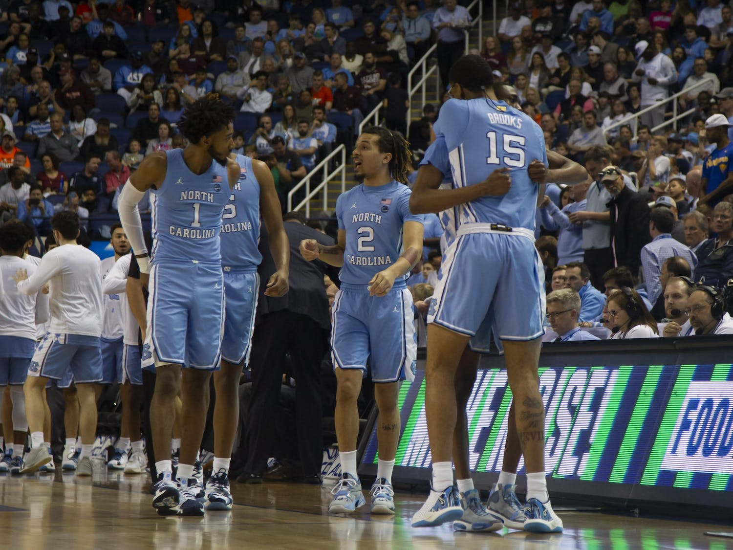 Junior forward Garrison Brooks (15) and senior guard Brandon Robinson (4) share a hug before the game against Virginia Tech in Greensboro Coliseum Complex on Tuesday, March 10, 2020. UNC beat Virginia Tech 78-56.