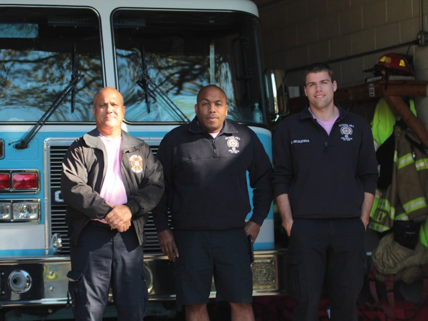 Chapel Hill Firefighters Richard Bucci (left), Devin McKenna (right) and Fire Equipment Operator Keith Alston (middle) pose at Chapel Hill Fire Station 2.