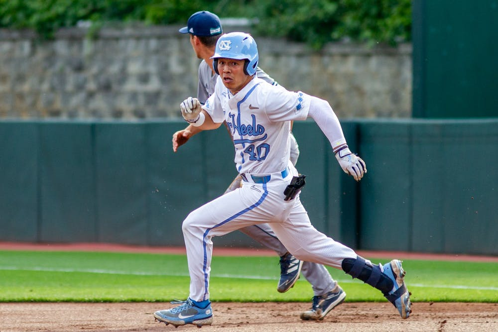 UNC redshirt sophomore outfielder Angel Zarate (40) runs to second base at the game against UNCW on Tuesday May 18, 2021 at Boshamer stadium. The Tar Heels won 14-9.