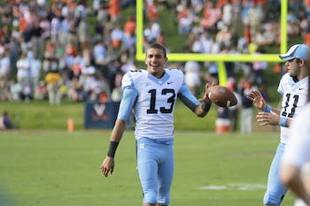 Former walk-on Mack Hollins led the Tar Heels in their match Saturday against the University of Virginia.  Hollins finished with two touchdowns and retrieved the ball for UNC on an onside kick recovery.