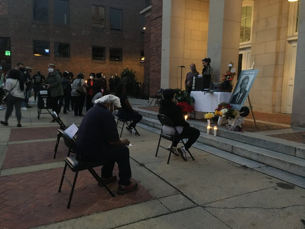 <p>People gather at the Peace and Justice Plaza in remembrance of James Lewis Cates on the 50th anniversary of his murder on Nov. 21, 2020.&nbsp;</p>