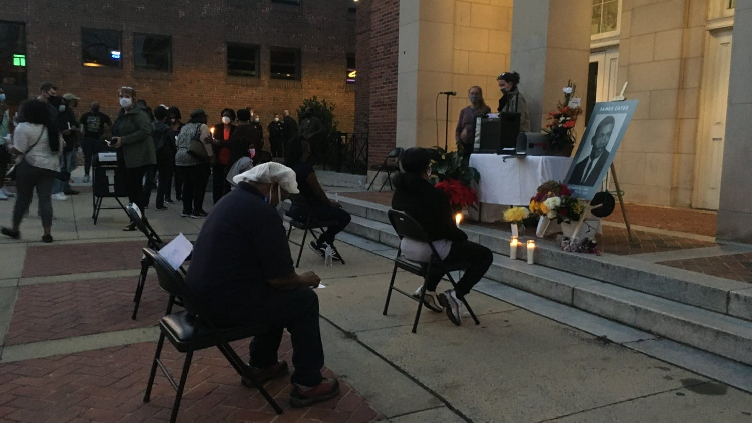 People gather at the Peace and Justice Plaza in remembrance of James Lewis Cates on the 50th anniversary of his murder on Nov. 21, 2020.