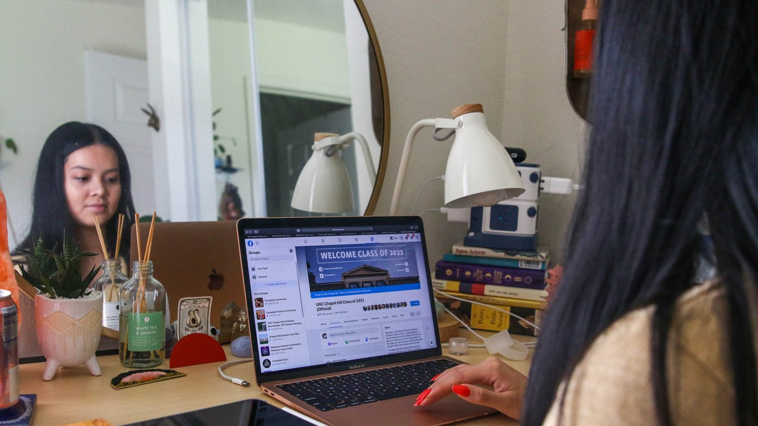 DTH photo illustration depicting a student searching through UNC's Facebook groups to find other students to connect with during the COVID-19 pandemic and online learning.