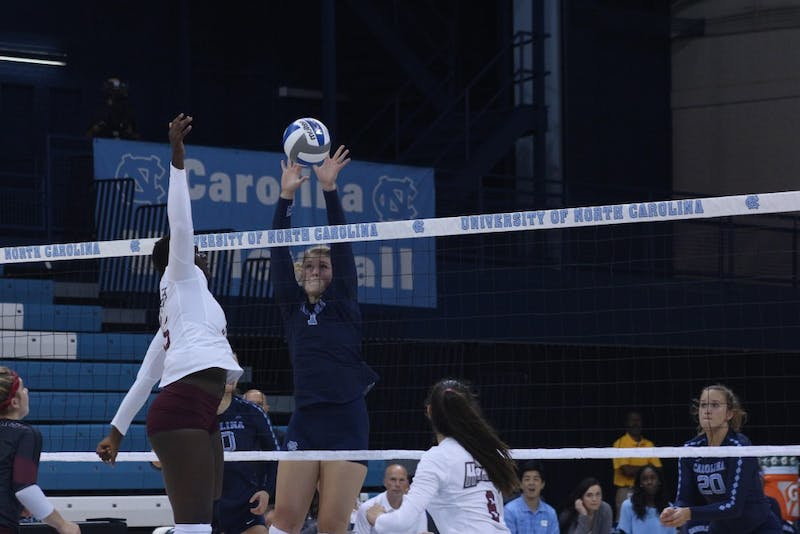 Sophomore middle hitter Katharine Esterley (7) blocks a spike against Maryland Eastern Shore on Aug. 31 in Chapel Hill.