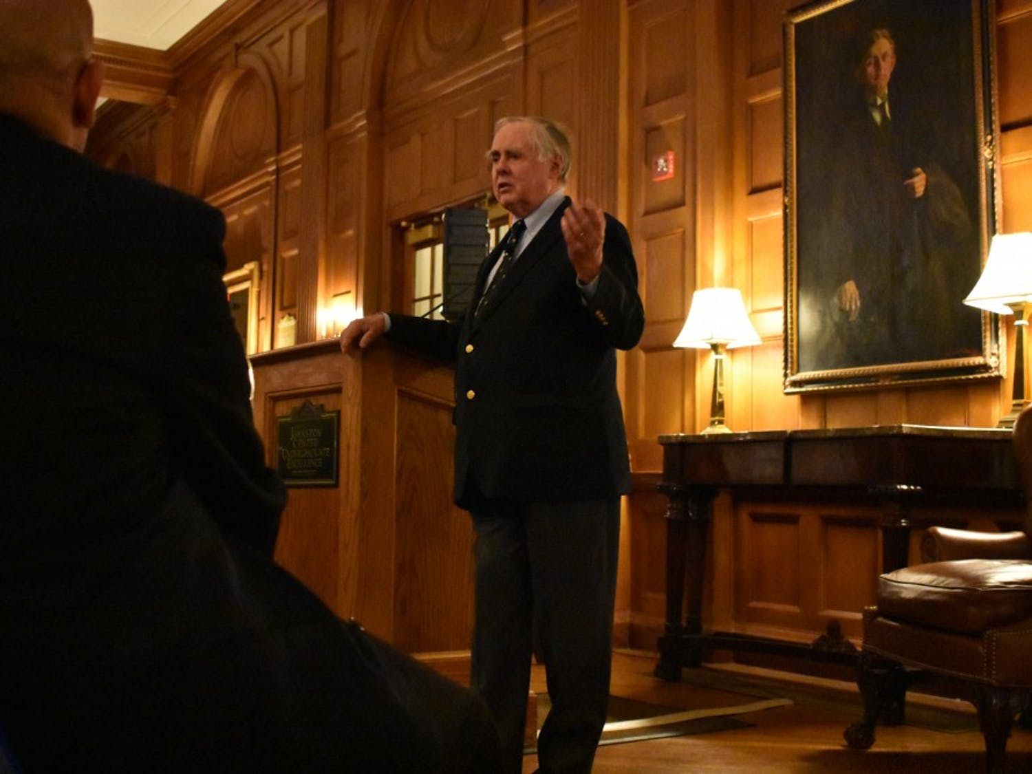 """Anthony Cecil Eden Quainton, a U.S. ambassador, fields questions about American international relations from the audience after his lecture at """"The Year Ahead in Foreign Policy"""" at Graham Memorial Hall on Tuesday, Nov. 27, 2018."""