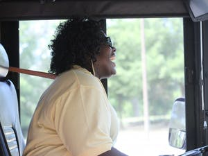 Tammy McNair, Chapel Hill Transit bus driver, smiles before driving the T route on Friday May 31, 2019.