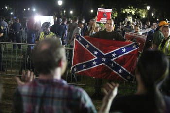 Demonstrators proudly displayed a Confederate flag and counter-protestors chanted in response on McCorkle Place Thursday night.
