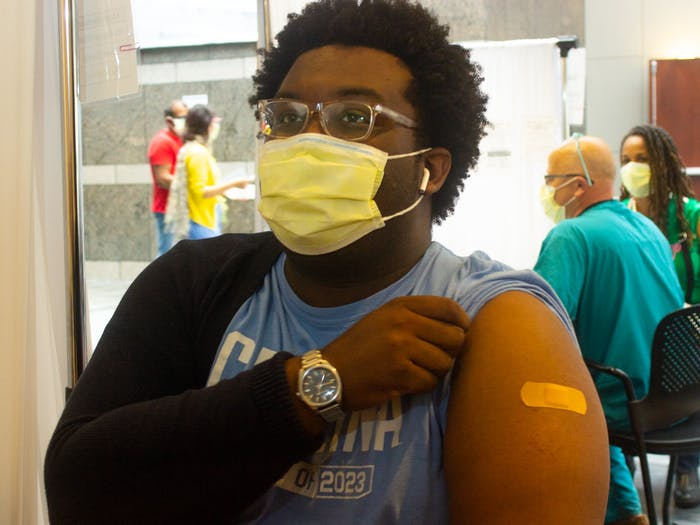UNC Student Body President Lamar Richards receives his COVID-19 vaccine at the Friday Center on Friday, March 26th, 2021.
