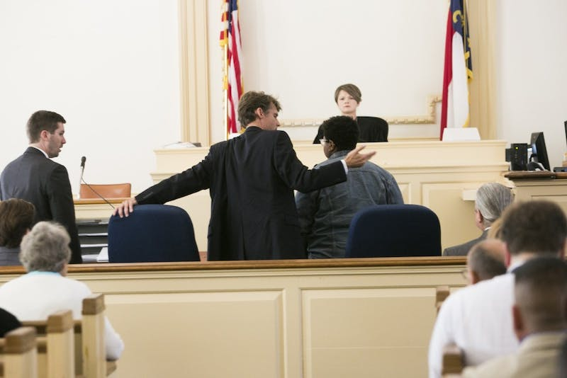 Maya Little and her lawyer finish up talks before the start of her hearing on Monday, Oct. 15, 2018, in Hillsboro N.C.