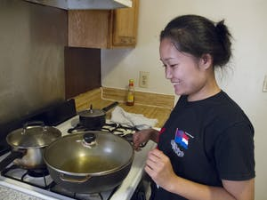 Khai Nyuitow prepares food for the Transplanting Traditions fundraising dinner on Sept. 30.