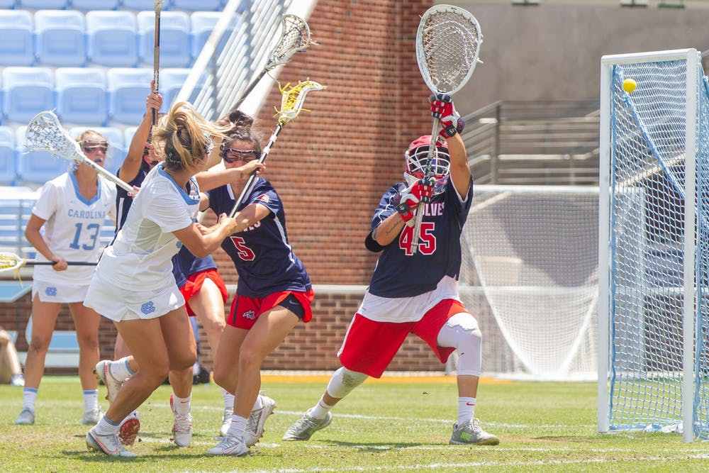 UNC senior attacker Jamie Ortega (3) scores a goal at the quarterfinals of the NCAA tournament against Stony Brook at the Dorrance Field in Chapel Hill on Saturday May 22, 2021. The Tar Heels won 14-11.