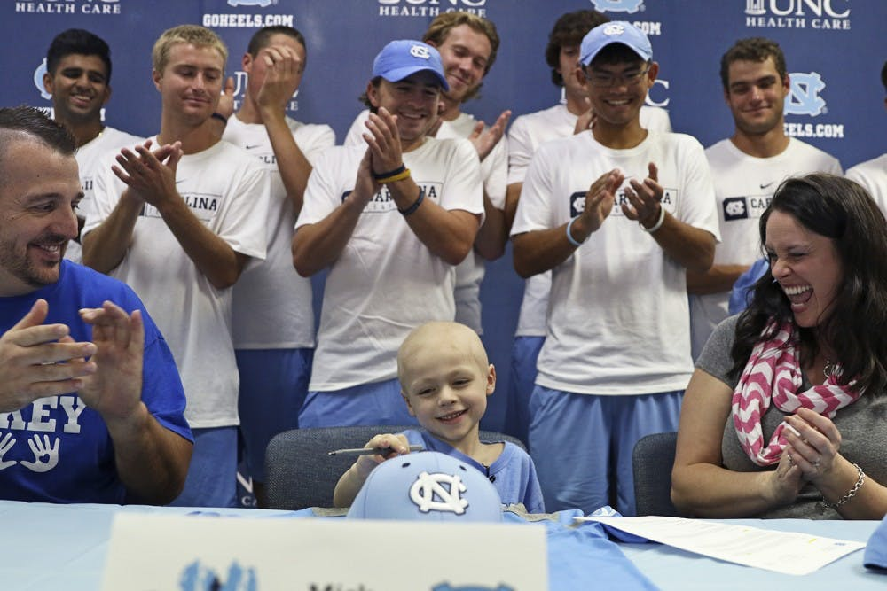 'That little boy battled with everything he had': 5-year-old Mick Macholl's legacy lives on for UNC men's tennis