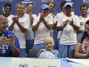 5-year-oldMickMacholl was officially signed to the UNC men's tennis team in November. This was an honorary gesture for Mick, who died after an 18-month battle withneuroblastoma on Dec. 13.
