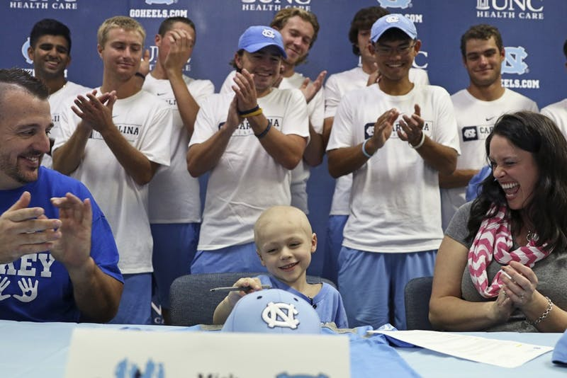 5-year-old Mick Macholl was officially signed to the UNC men's tennis team in November. This was an honorary gesture for Mick, who died after an 18-month battle with neuroblastoma on Dec. 13.