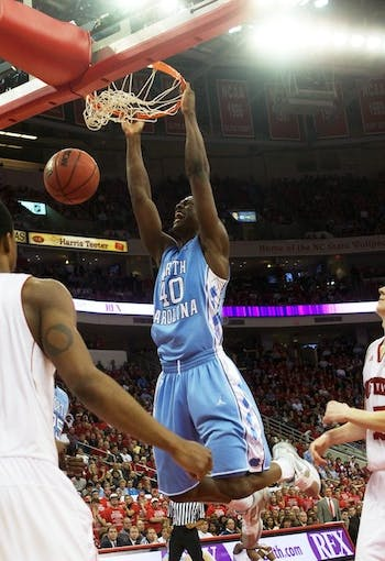 Harrison Barnes dunks late in the second half of the Tar Heels' 75-63 win over the Wolfpack.